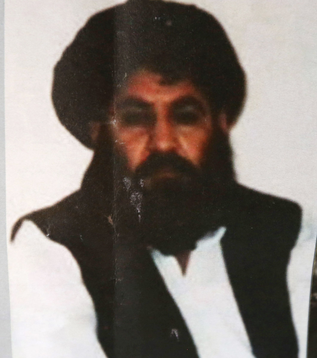 FILE - This Saturday, Aug. 1, 2015 file photo, shows Taliban leader Mullah Mansour. The Afghan Taliban has confirmed that its former leader Mullah Akhtar Mansour was killed in a U.S. drone strike last week and appointed a successor. In a statement sent to media Wednesday, May 25, 2016, the insurgent group said its new leader is Mullah Haibatullah Akhundzada, one of two Mansour's deputies. (AP Photo/Rahmat Gul, File)