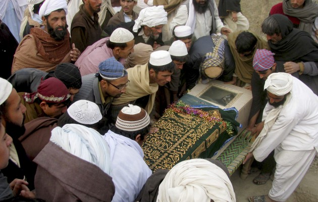 Pakistani villagers at funeral of drone victim - December 29 2010- AP