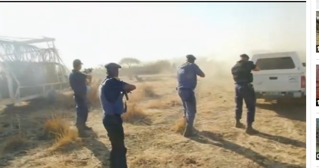 South African police- Screengrab/ Guardian video