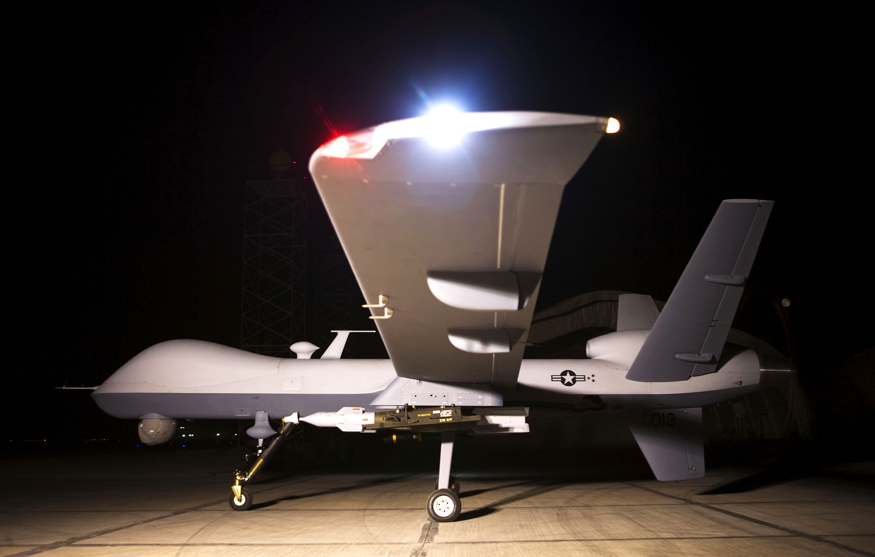An MQ-9 Reaper sits on a ramp in Afghanistan Oct. 1. The Reaper is launched, recovered and maintained at deployed locations, while being remotely operated by pilots and sensor operators at Creech Air Force Base, Nev. (Courtesy photo/US Air Force)