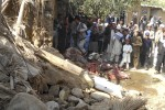 Students gather at the site of a suspected U.S. drone strike on an Islamic seminary in Hangu district