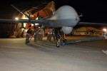 Airmen manhandle an MQ-9 Reaper drone used in Afghanistan by the US