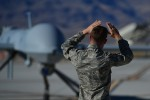 A crew chief from the 432nd Aircraft Maintenance Squadron taxis in an MQ-1 Predator remotely piloted aircraft during a post-flight inspection Nov. 1, 2013. Predators can perform the following missions and tasks: intelligence, surveillance, reconnaissance, close air support, combat search and rescue, precision strike, buddy-lase, convoy/raid overwatch, route clearance, target development, and terminal air guidance. The USAF's MQ-9 Reaper and MQ-1 Predator fleet surpassed 2 million cumulative flight hours on Oct. 22, 2013.
