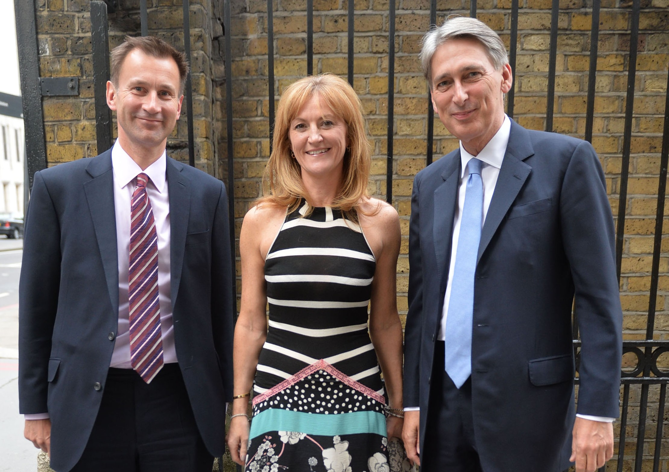 Jeremy Hunt and Phillip Hammond and his wife Susan arrive at the Conservative Summer Party 2013 at Old Billingsgate