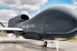 A Nato badged RQ-4 Block 20 Global Hawk unmanned reconnaissance system sitting on the tarmarc at Farnborough 2010