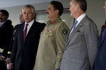 U.S. Defense Secretary Chuck Hagel, in a dark suit and red tie, addresses the press after meeting with Pakistani Chief of Army Staff Gen. Raheel Sharif, wearing the olive green uniform of the head of the Pakistan Army. They are meeting in Islamabad, Pakistan, Dec. 9, 2013.