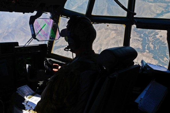 U.S. Air Force Capt. Matt Buchholtz looks out the window of his C-130J Super Hercules aircraft while flying a medical evacuation mission over Afghanistan, Sept. 4, 2015. Buchholtz is a pilot assigned to the 774th Expeditionary Airlift Squadron.