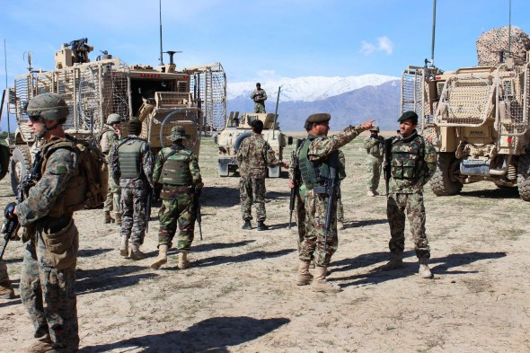 U.S. Marines and Georgian and Afghan soldiers prepare their equipment before conducting a patrol near Bagram Airfield, Afghanistan, April 6, 2015. U.S. Army photo by Lt. Col. Amanda Azubuike