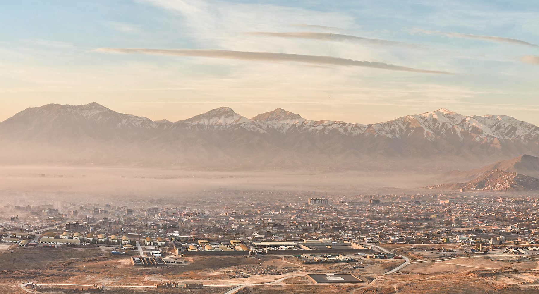 A view over Camp Qarga and the Afghan National Army Officer Academy in Kabul, Afghanistan at sunrise.