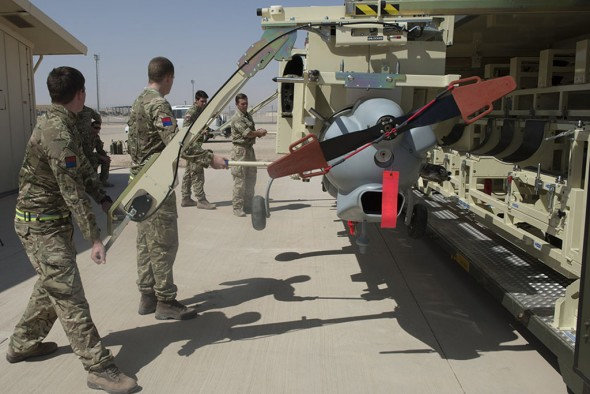 Image shows a 4 man team from 43 Battery, 47 Regiment, Royal Artillery, led by Corporal Si Downey assembling a Watchkeeper Unmanned Aerial Vehicle (UAV) in Camp Bastion, Afghanistan, 23rd September 2014. The Ministry of Defence has announced that the Army's next generation of Unmanned Air System (UAS), Watchkeeper, is now fully operational in Afghanistan. This new capability is providing force protection for British troops as they prepare to draw down from Afghanistan by the end of this year. Footage released today shows Watchkeeper carrying out surveillance tasks and gaining situational awareness via its cutting edge cameras and radar capability, a new asset for the UK's Armed Forces. Credit should read: Cpl Mark Larner RY