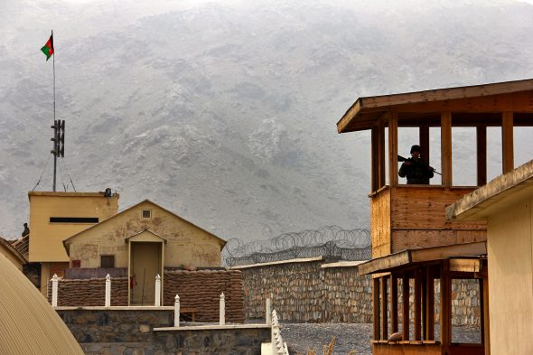 An Afghan army soldier provides security from a guard tower during meetings at the Khyber Border Coordination Center near Torkham Gate at the Afghanistan-Pakistan border in Afghanistan's Nangarhar province, Jan. 4, 2015.