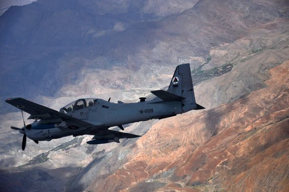 An Afghan air force A-29 Super Tucano aircraft flies over Afghanistan during a training mission, April 6, 2016. NATO Train, Advise, Assist Command-Air works daily to assist the Afghan air force in improving its capabilities. Air Force photo by Capt. Eydie Sakura