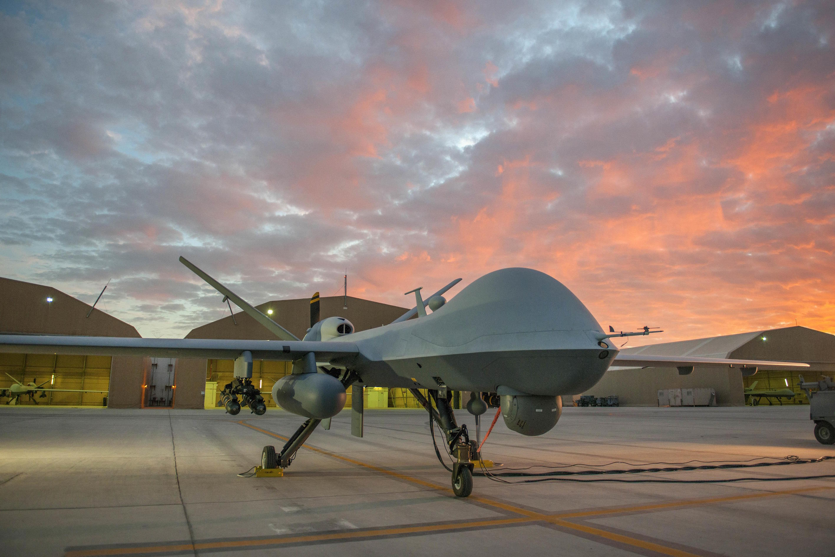 An MQ-9 Reaper equipped with an extended range modification sits on the ramp on Kandahar Airfield, Afghanistan, Dec. 6, 2015, before a sortie. U.S. Air Force photo by Tech. Sgt. Robert Cloys