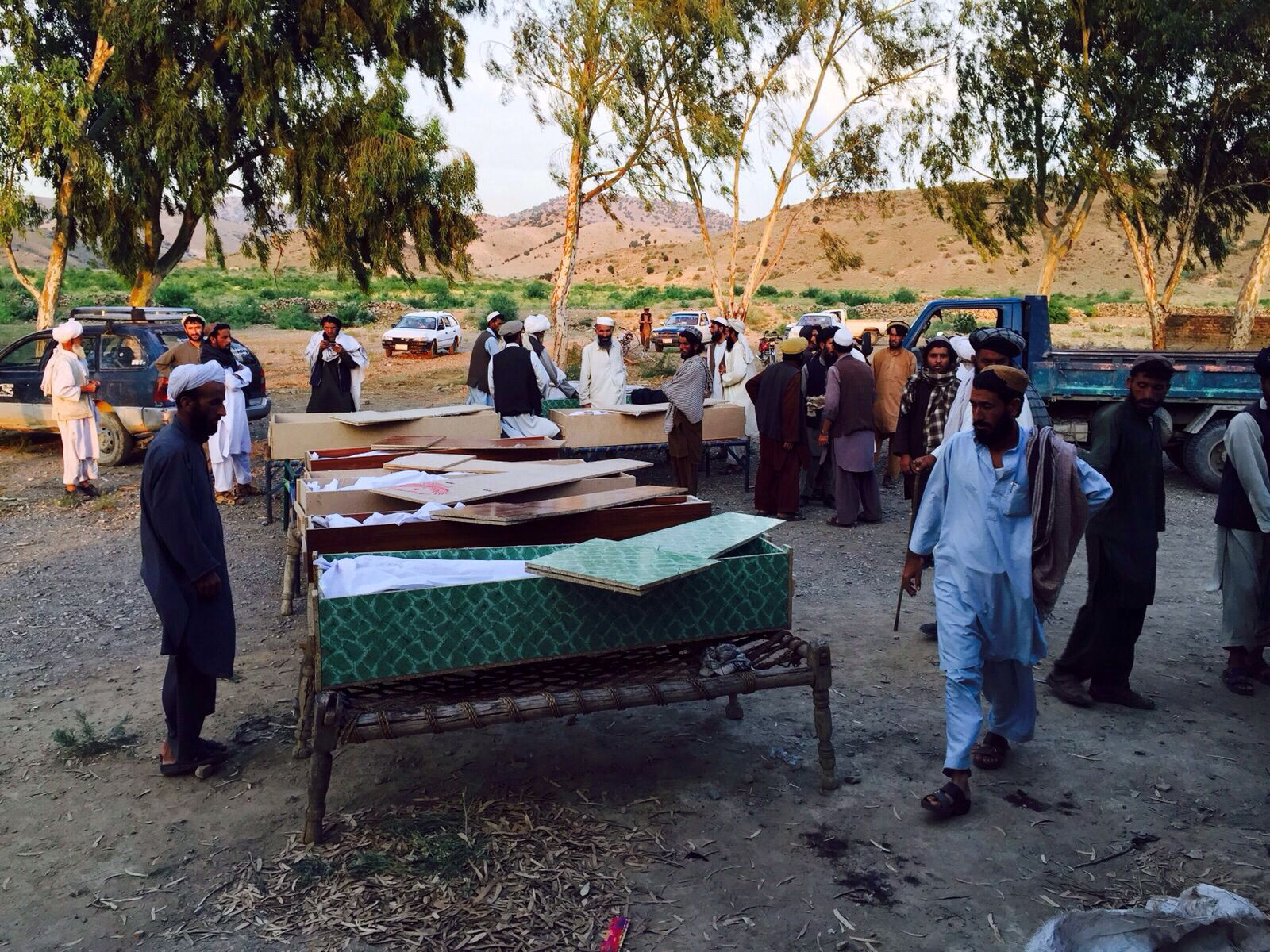Kochi tribesmen stand around the open coffins of their family and friends after a drone strike killed 14 people who were either attending a wedding or returning from an attack on a police outpost. The attack hit on June 5 2015 in Khost province, Afghanistan.