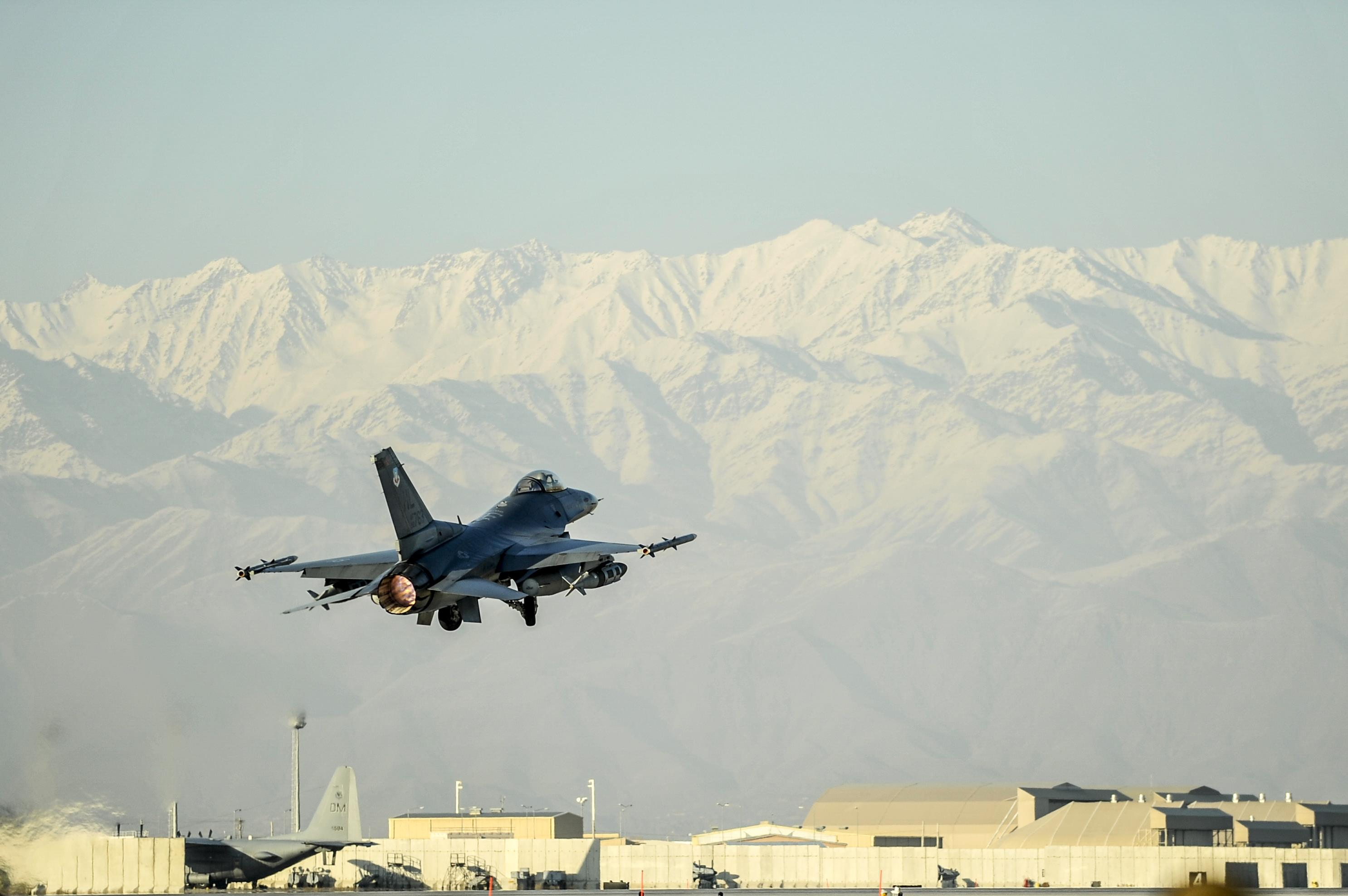 421st EFS 'Black Widows' provide combat airpower A US F-16 jet takes off in Afghanistan before a horizon of snow-capped mountains