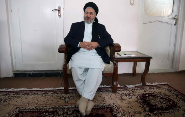 In this Thursday, Oct. 29, 2015 photo, Afghanistan's Minister of Refugees and Repatriation, Hossain Alemi Balkhi talks during an interview with the Associated Press at his home in Kabul, Afghanistan. An estimated 120,000 Afghans have left for Europe so far this year, according to Balkhi, He expects that number to reach 160,000 by the end of the year, four times the number who departed in 2013. (AP Photos/Massoud Hossaini)