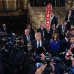 Donald Trump talks to reporters in Detroit during the 2016 US election campaign.