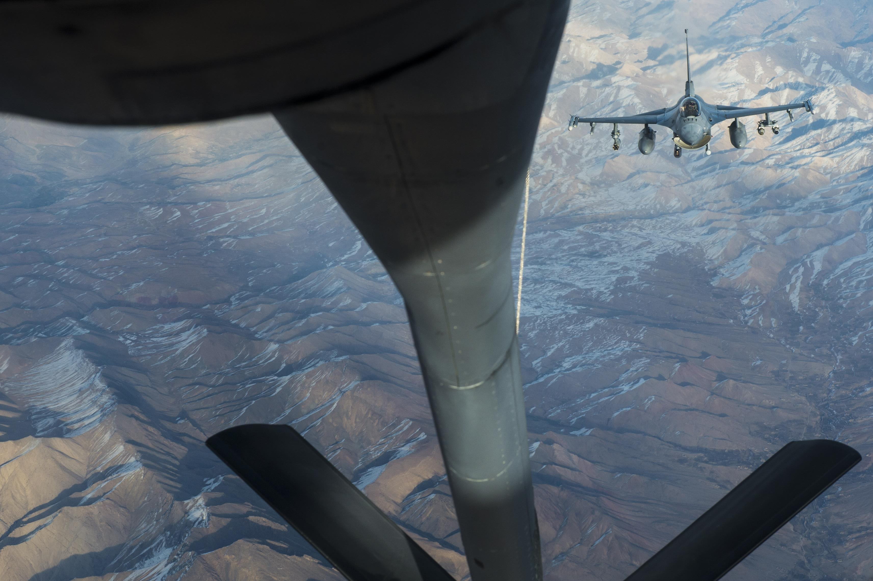 An Air Force F-16 Fighting Falcon approaches a KC-135 Stratotanker for aerial refueling to support an Operation Freedom's Sentinel mission over Afghanistan, Dec. 21, 2016. The 340th Expeditionary Air Refueling Squadron is actively engaged in tactical refueling operations, which extend kinetic capabilities across Southwest Asia. Air Force photo by Staff Sgt. Matthew B. Fredericks